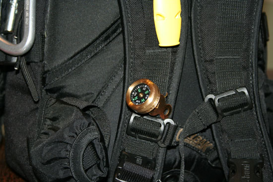 Closer detail of Rescue Howler whistle and Marble's Compass